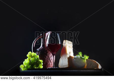 Assorted Cheeses And Homemade Red Wine. Hard And Soft Cheeses. Homemade Wine In A Ceramic Jug. Frees