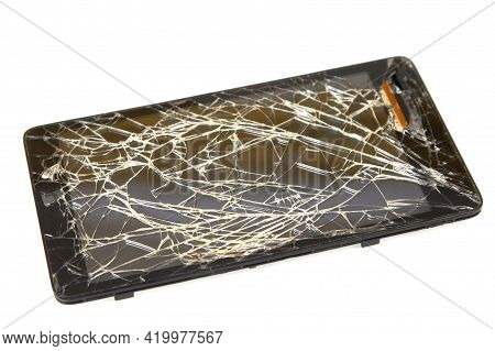 Broken Black Mobile Phone On White Background. Broken Smartphone Display.