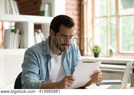 Satisfied Businessman In Glasses Reading Letter, Working With Correspondence