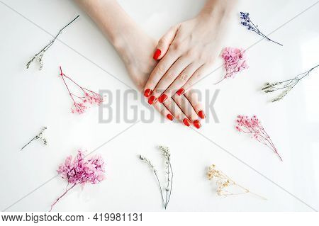 Manicured Womans Nails With Red Nail Polish.