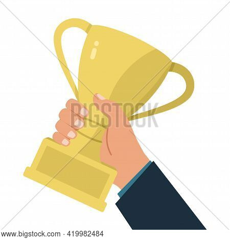 Vector Illustration Of A Hand Holding A Gold Trophy Cup. The Champion Holds The Award For The Winnin