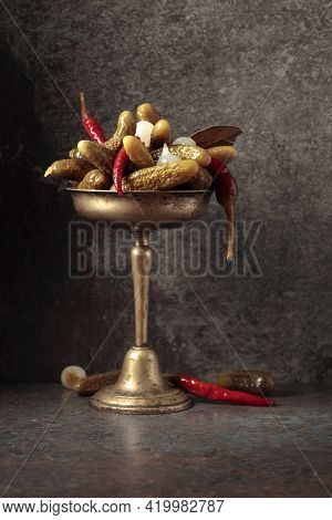 Canned Cucumbers With Peppers And Onions In Old Brass Dish. Preserved Vegetables On A Rustic Backgro