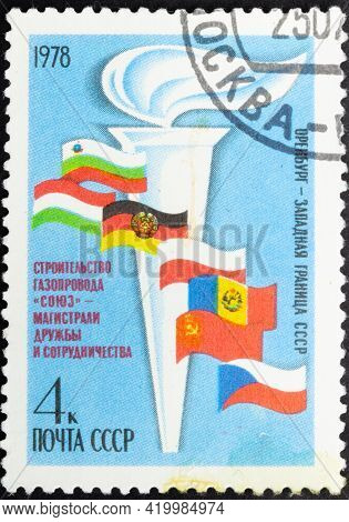 Ussr - Circa 1978: Postage Stamp 'symbolic Torch With Flags Of States'. Series: 'construction Of The