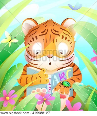 Litttle Cute Tiger Reading A Book In The Jungle Among Green Leaves And Grass. Colorful Tiger Animal