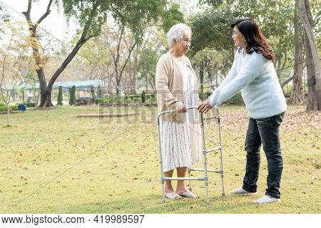 Help And Care Asian Senior Or Elderly Old Lady Woman Use Walker With Strong Health While Walking At