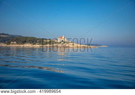 Lighthouse On Rocks Near Island Vis In Dalmatia, Croatia