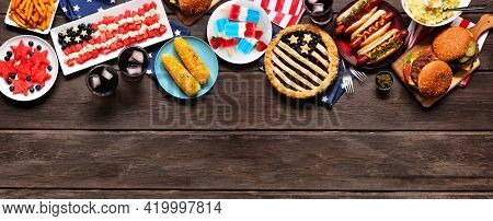 Fourth Of July, Patriotic, American Themed Food. Overhead View Top Border On A Dark Wood Banner Back
