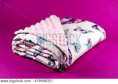 Sweet And Cute Baby Blanket With Butterfly Pattern Isolated On Pink Background
