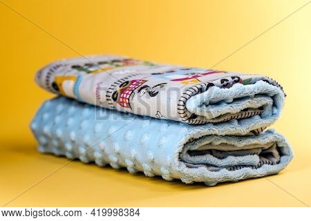 Sweet And Cute Baby Blanket With Train Pattern Isolated On Yellow Background
