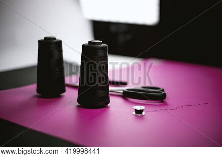 Black Tailoring Accessories On Pink Background