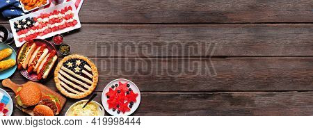 Fourth Of July, Patriotic, American Themed Food. Overhead View Corner Border On A Dark Wood Banner B