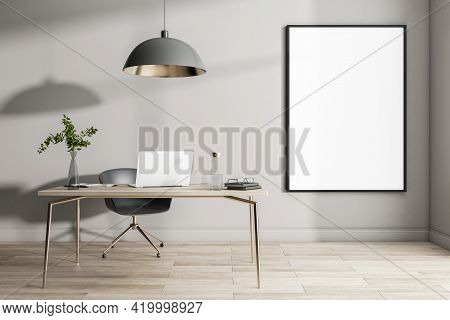 Blank White Poster In Black Frame On Light Wall In Sunny Home Office With Wooden Floor And Table Wit