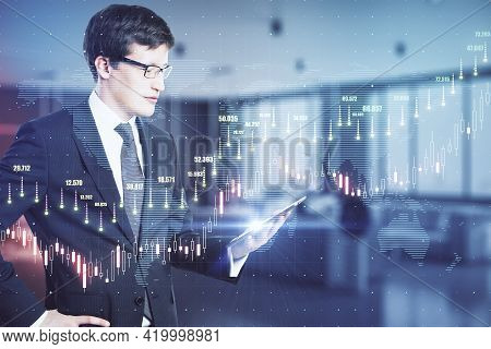 Global Trading Cocnept With Trader Looking At Digital Tablet Screen And Virtual Transparent Screen W