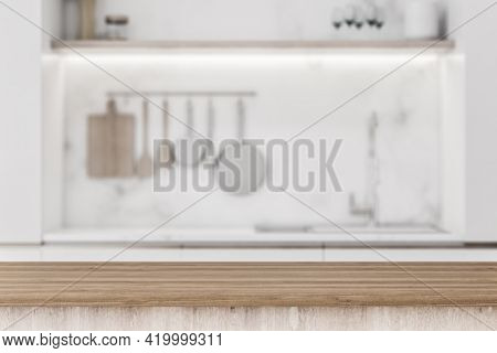 Stylish Wooden Tabletop With Copyspace For Your Text At Blurry Kitchen Utensils And Dishes On Light