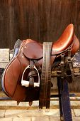 Horse riders complements rigs mounts leather over wood poster