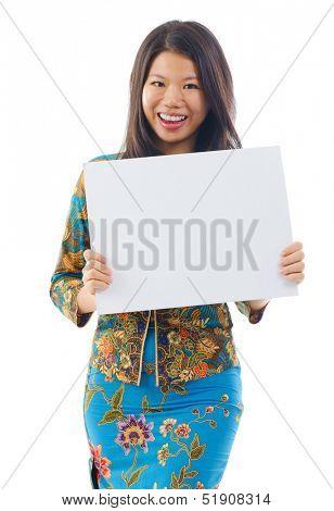 Asian woman in Kebaya holding a white blank card, kebaya usually worn by women in Indonesia, Malaysia, Brunei, Burma, Singapore, southern Thailand.