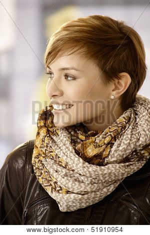 Profile portrait of Young woman wearing scarf and leather jacket