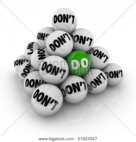 Several balls marked Don't in a pyramid and one with the word Do to illustrate permission, acceptance and a positive attitude to acheive a goal