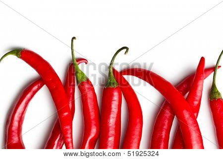 top view of chili peppers on white background