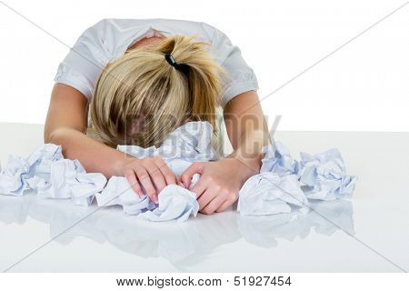 a young woman desperately in office between many file folders and crumpled papier.symbolfoto for stress, burnout and overwork. poster