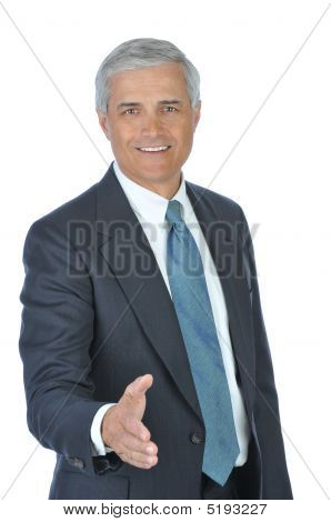 Middle Aged Businessman With Extended Hand