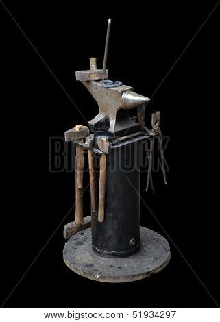 Isolated Blacksmith Anvil On The Frame And A Set Of Blacksmith Tools