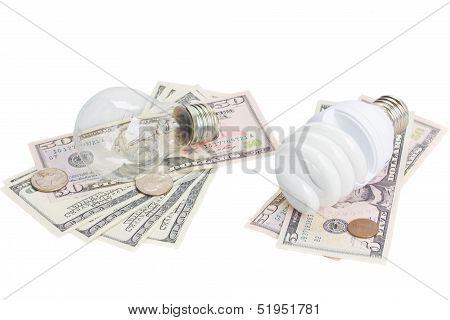 energy saving and normal   bulbs on dollars money