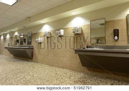 Modern Public bathroom with ceramic floors