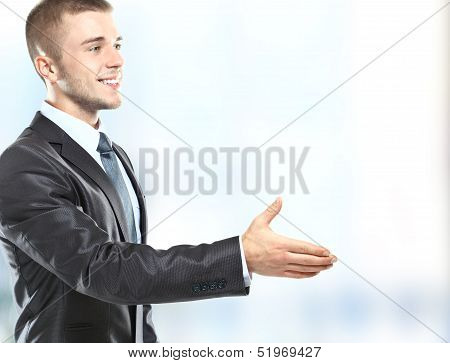 businessman handshake hold hand welcome gesture Handsome young excited business man happy smile wear elegant suit and tie poster