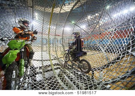 MOSCOW - MAR 23: Two stuntmen  show a thumbs up inside a mesh ball on Show Monster Mania in Olimpiyskiy in March 23, 2013 in Moscow, Russia.