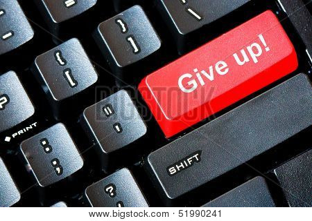 Red Give Up button on a computer keyboard