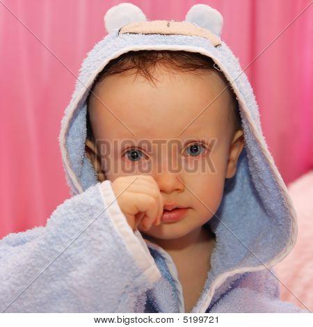 Little Boy Dressed In Blue Bathrobe