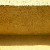 shades of orange stucco wall close up poster