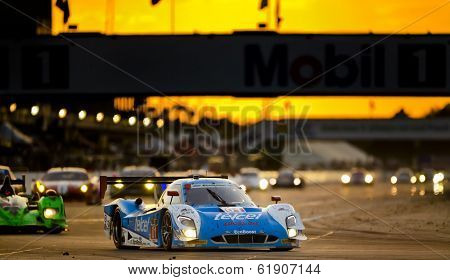 Sebring, FL - Mar 15, 2014:  The Telcel Ford EcoBoost travels through turn one at sunset during the 12 Hours of Sebring at Sebring International Raceway in Sebring, FL.