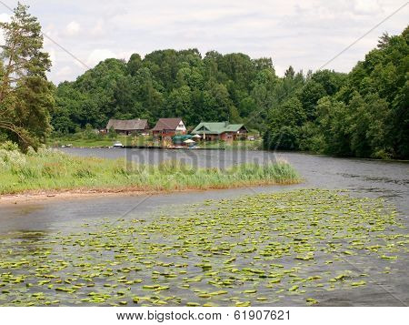 Kaunas artificial sea - Nemunas river weir and houses at Rumsiskes. Lithuania. poster