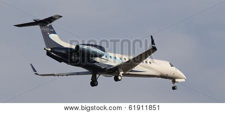 Embraer EMB-135BJ Legacy 600 business aircraft on the blue sky background