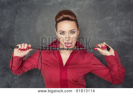 Woman With Whip In Her Hands