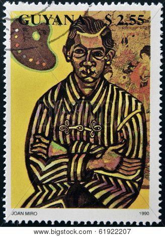 GUAYANA - CIRCA 1990: A stamp printed in Guyana shows Joan Miro Portrait of Enric Cristofol Ricart