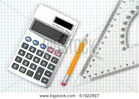 Calculator, lead pencil and ruler