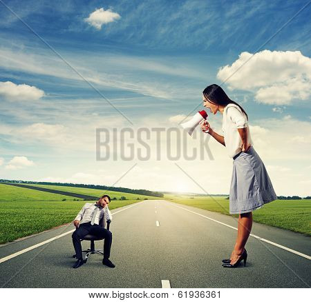 angry young woman and tired young man on the road
