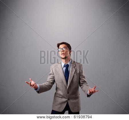 funny man standing and juggling with copy space poster