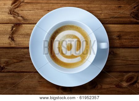 'at' symbol in coffee cup concept for social media, e-mai, internet cafe or business meeting
