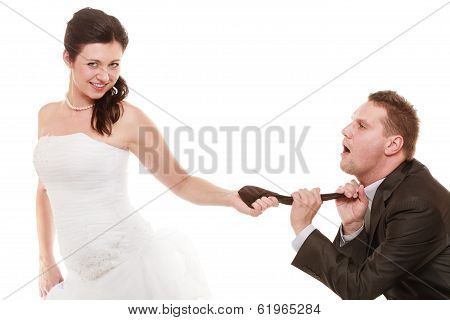 Wedding. Bride Pulling Tie Of Groom. Emancipation