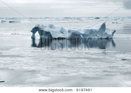 Iceberg In Calm Waters