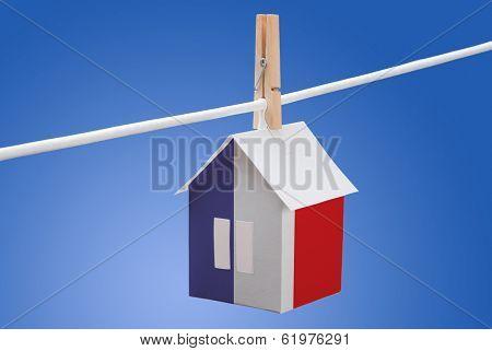 France flag on paper house