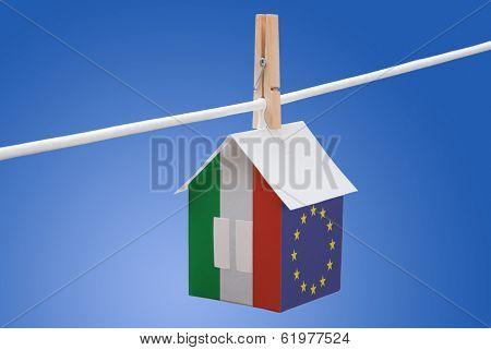 Italy, Italian and EU flag on paper house
