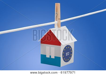 Luxembourg and EU flag on paper house