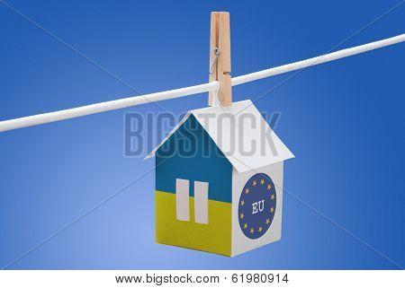 Ukraine, Ukrainian and EU flag on paper house