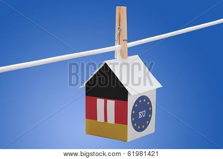 Germany and EU flag on paper house