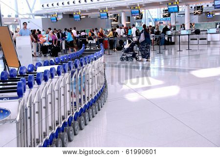 Passengers lining up at the check-in counter at the modern international airport